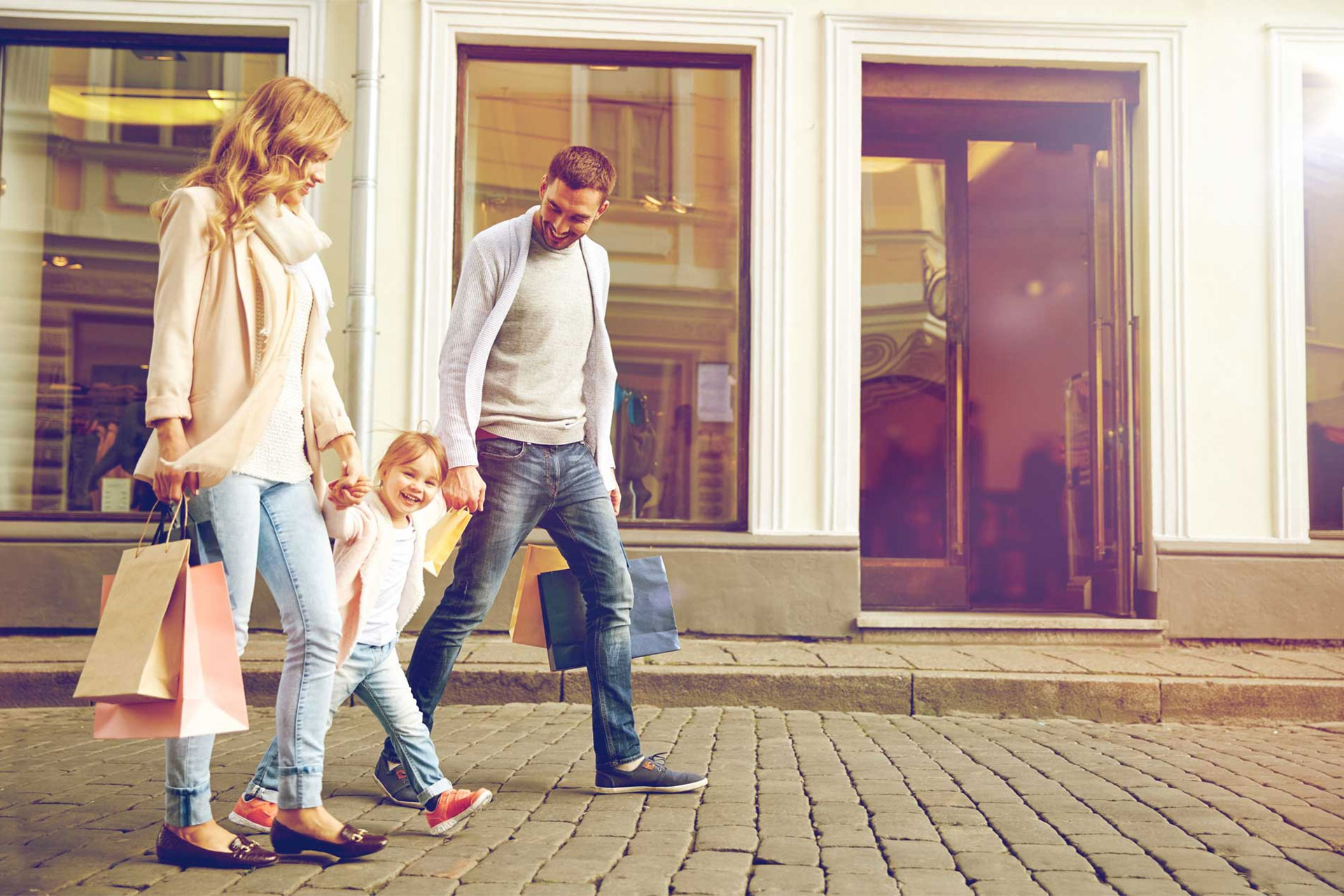 Young couple with daughter shopping